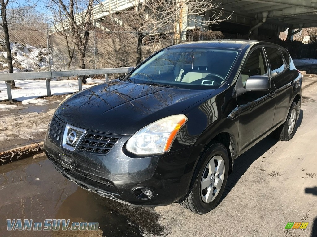 Wicked Black / Gray Nissan Rogue S AWD
