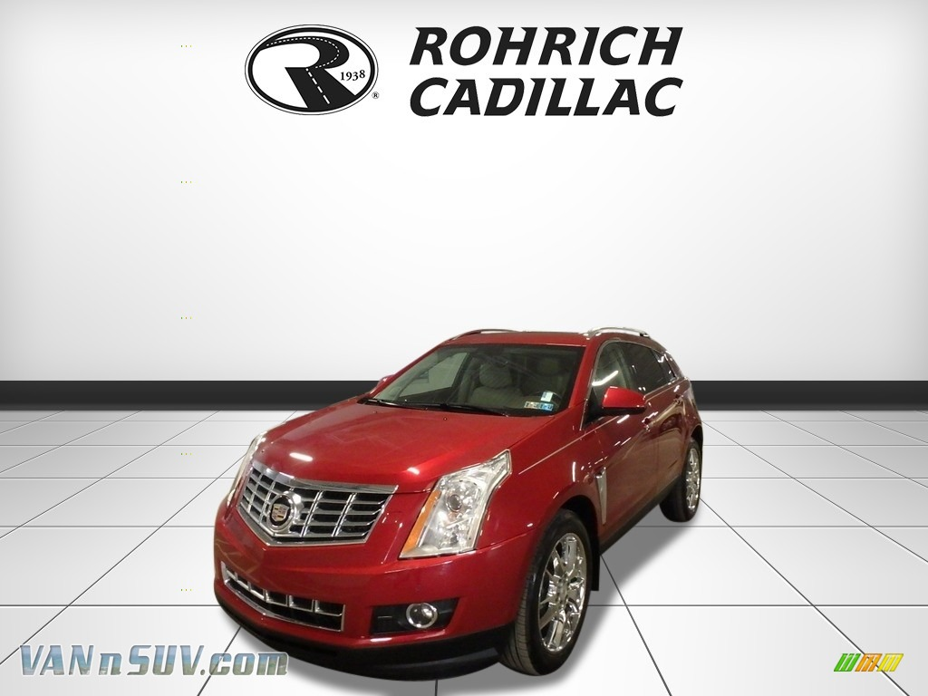 Crystal Red Tintcoat / Shale/Brownstone Cadillac SRX Performance AWD