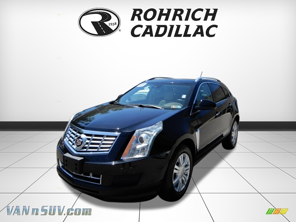Black Raven / Shale/Brownstone Cadillac SRX Luxury AWD