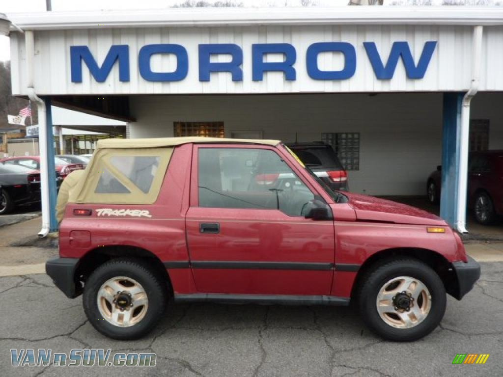 Sunset red metallic charcoal chevrolet tracker soft top 4x4