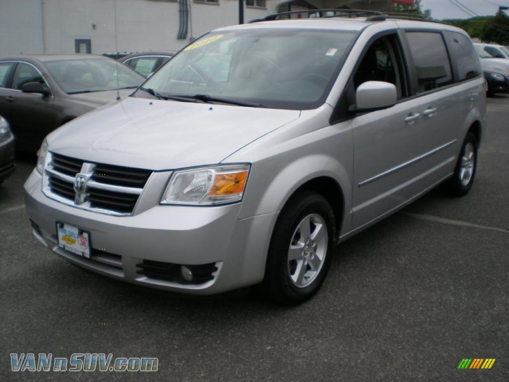 2010 grand caravan sxt bright silver metallic dark slate gray light shale photo