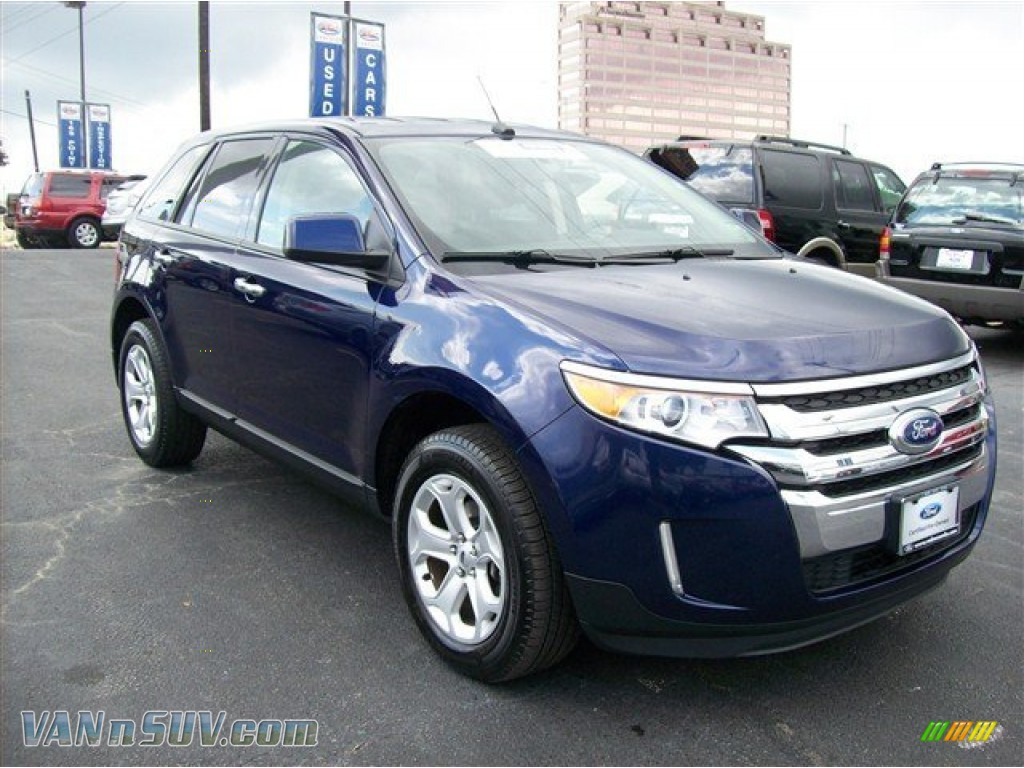 Kona Blue Metallic Charcoal Black Ford Edge Sel Awd